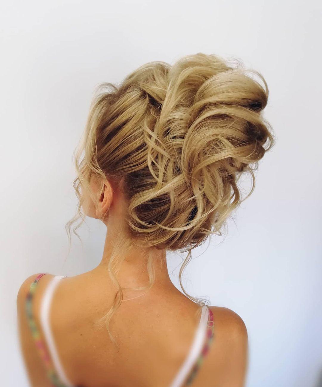 Voluminous Wavy Updo Hairstyle