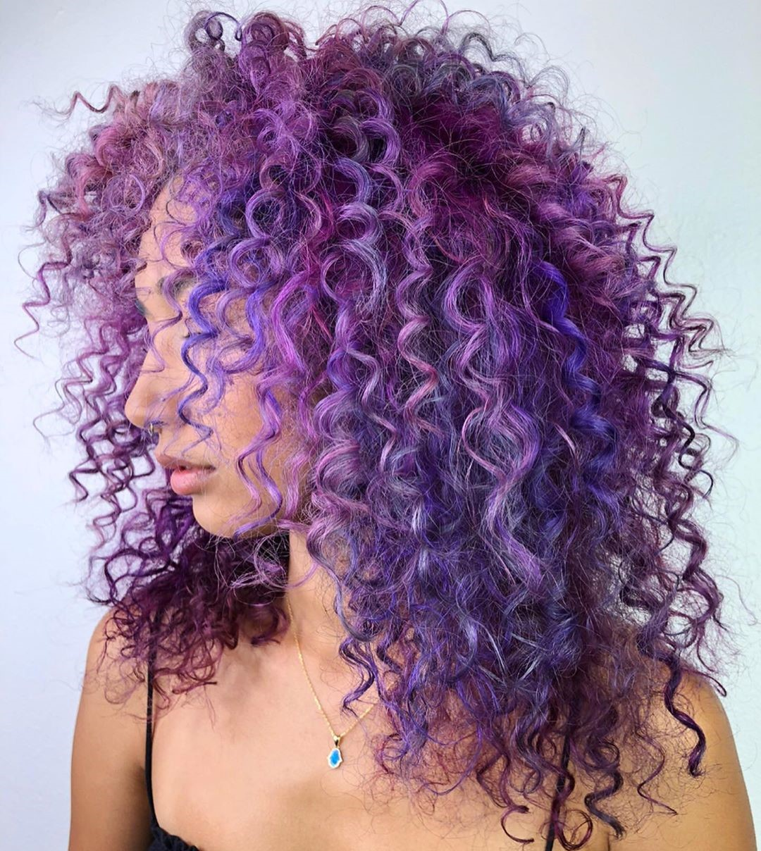 Curly Purple Hair with Blue Highlights