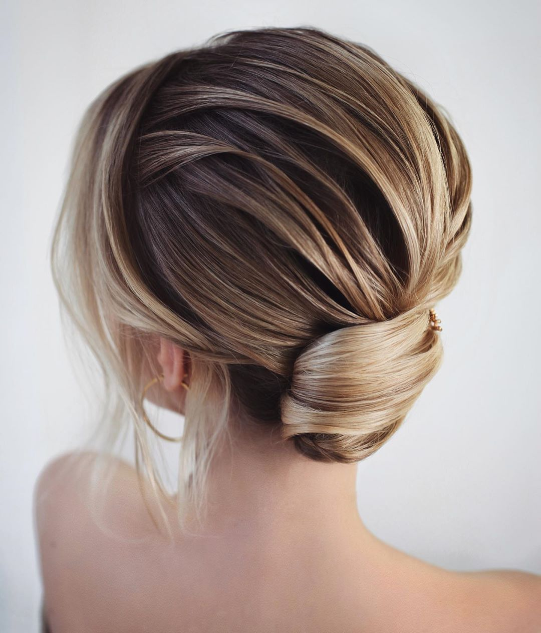 Sophisticated Short Hair Nape Bun with a Fringe