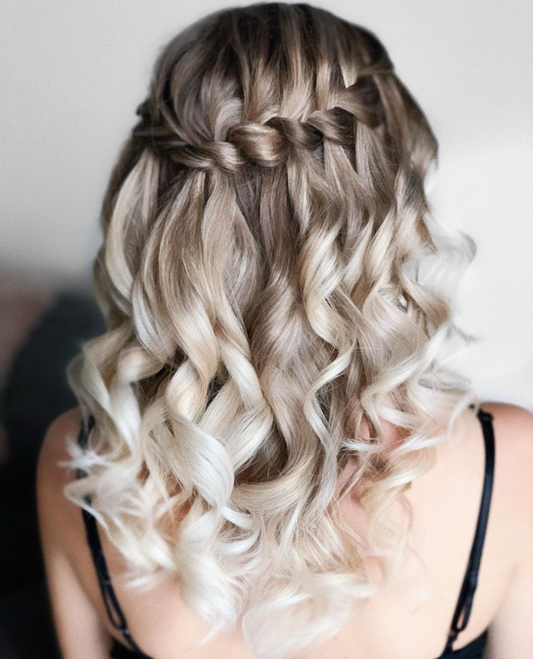 Half Up Half Down Curly Hairstyle with a Halo