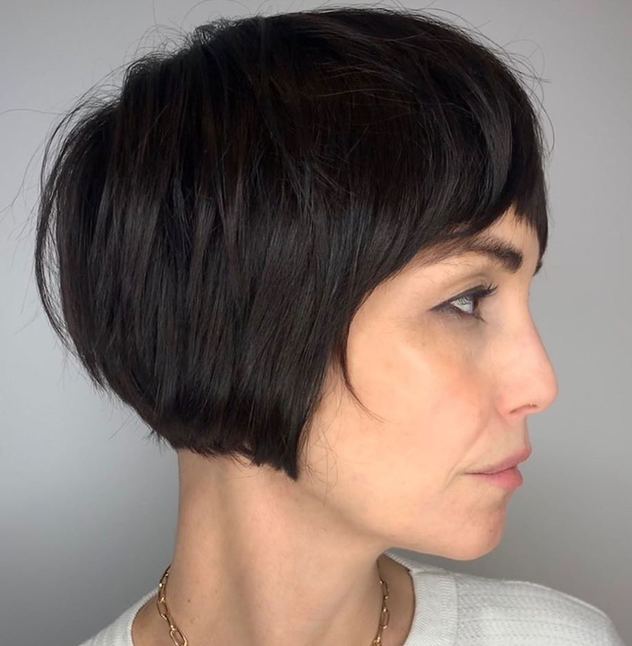 Feminine Short Bob Haircut with Bangs