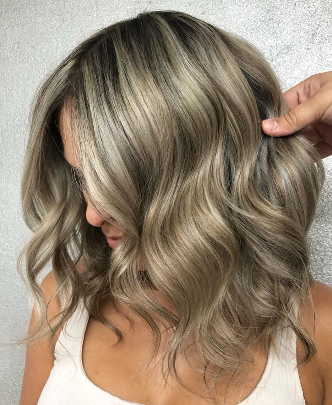 Sandy Blonde Hair with Ash Blonde Highlights