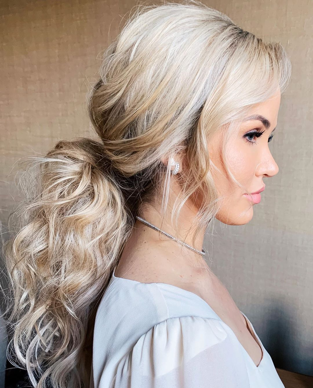 Long Curly Ponytail with Side Bangs
