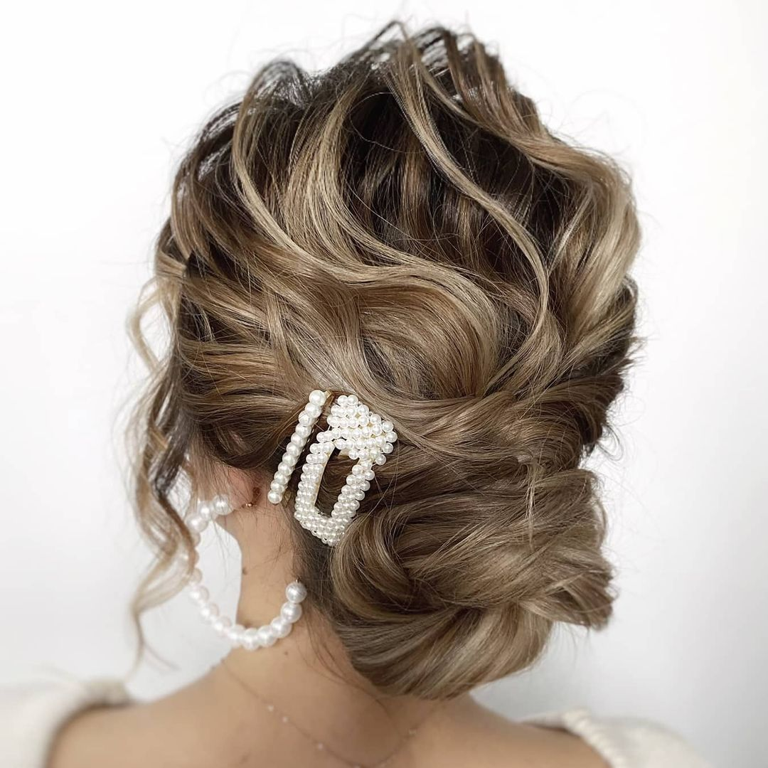 Messy Low Curly Bun Updo