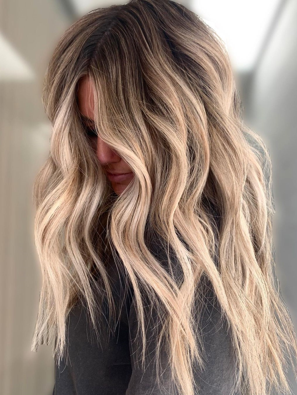 Long Haircut with Dirty Blonde Highlights