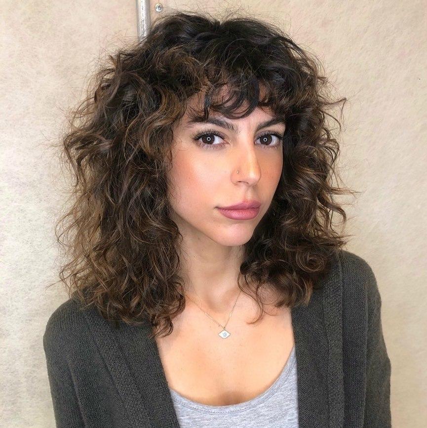 Medium Wavy Hair with Curly Bangs