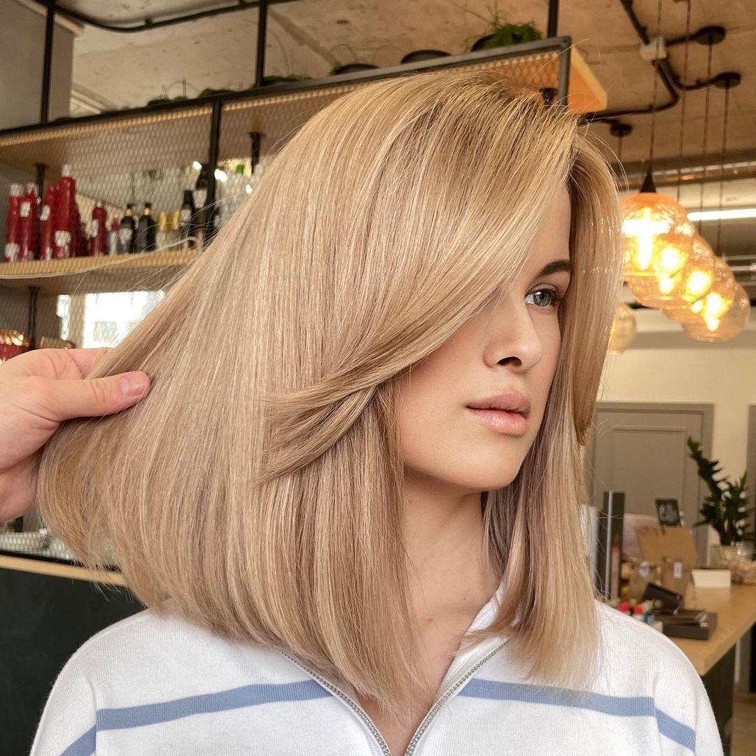 Shoulder-Length Haircut with Long Bangs