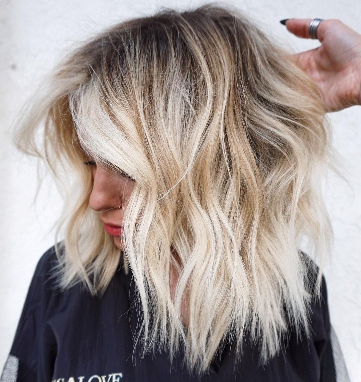 Blonde Choppy Medium Length Haircut