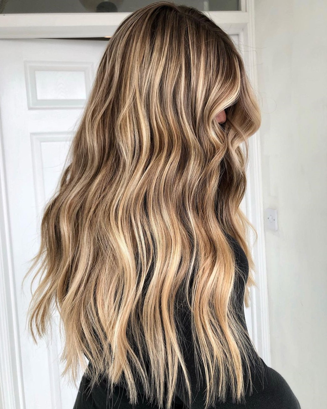 Long Dirty Blonde Hair with Highlights