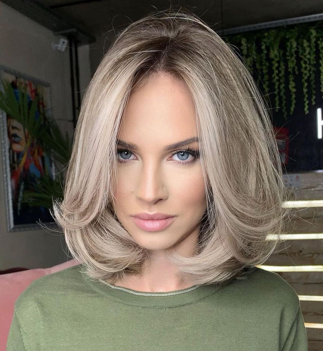 Haircut with Swoopy Layers for Big Foreheads