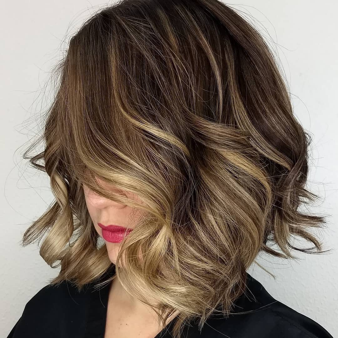 Short Curly Hair with Blonde Highlights