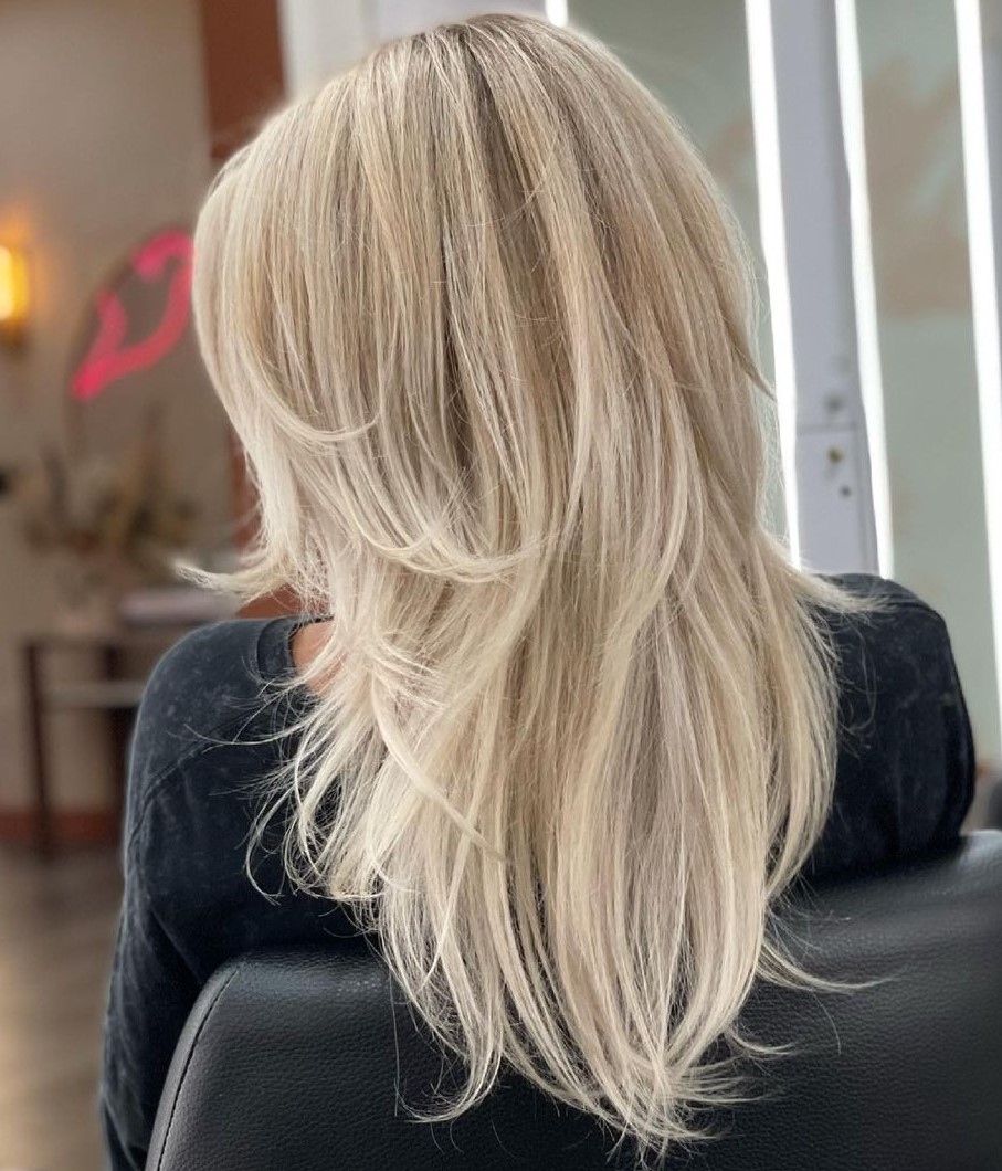 Blonde V-Cut with Wispy Layers and Bangs