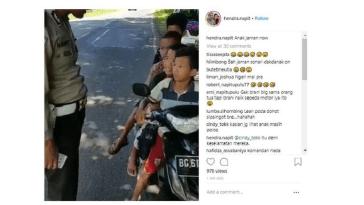 Video viral, polisi tilang anak naik motor berboncengan empat