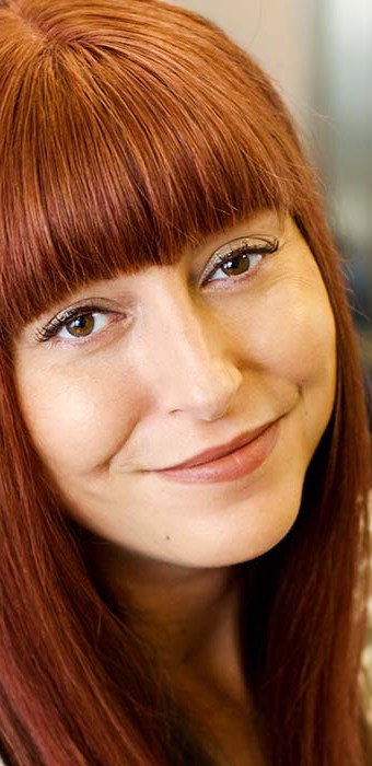Smiling female with red Enhancer System and fringe