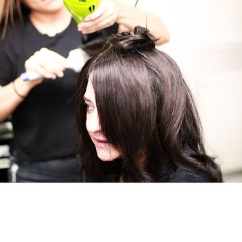 Female client with brown hair having blow dry