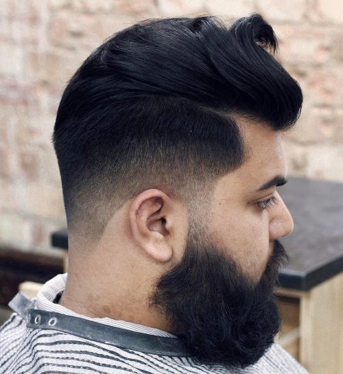 Slicked Back Mid Fade Haircut