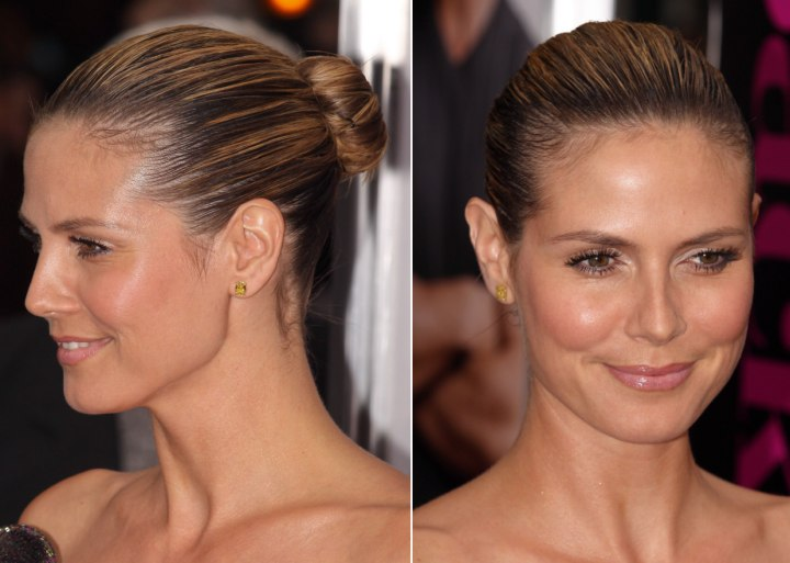 Heidi Klum With Her Hair Severely Pulled Back Into A