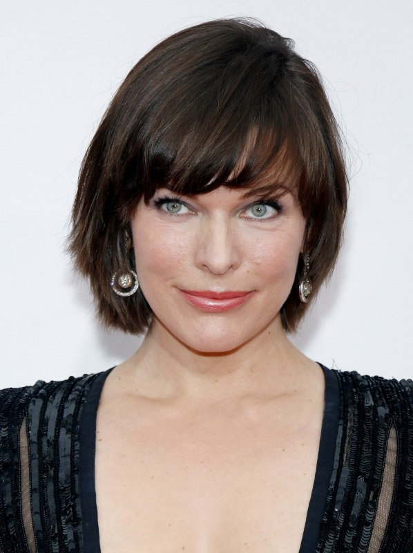 Milla Jovovich With Her Hair Cut In A Sleek Short Style