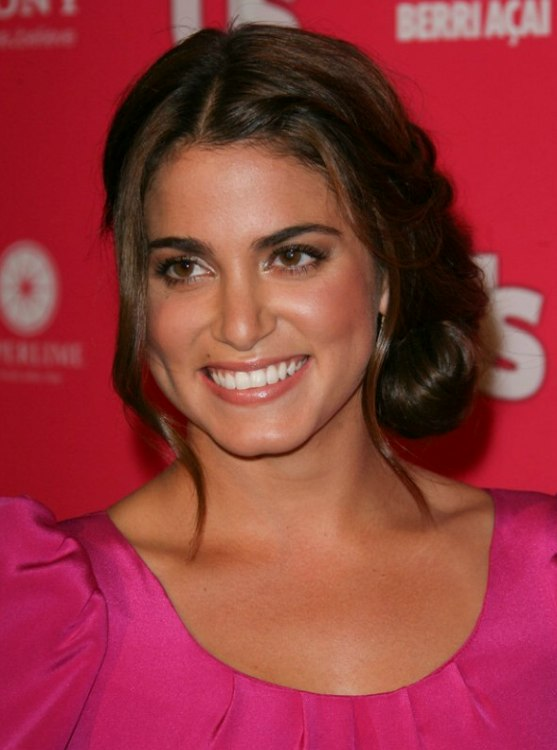 Nikki Reed Wearing Her Hair In An Updo With A Plaited Bun