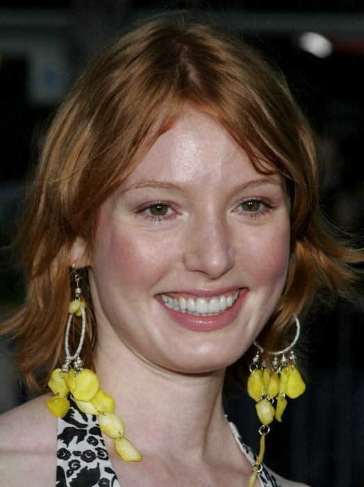 Alicia Witt With Her Red Hair Cut To Mid Length In A Shag