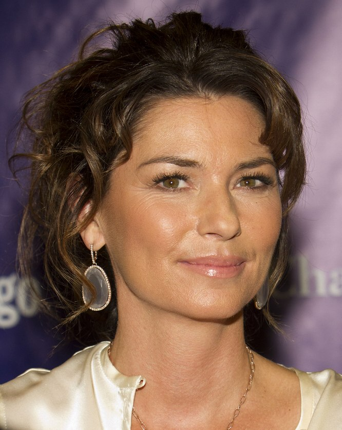 Shania Twain Curled Updo With The Hair Pulled Back For