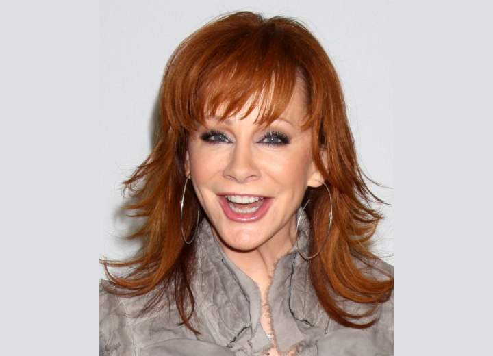 Reba McEntire Long Chiseled Hairstyle For 50 Plus