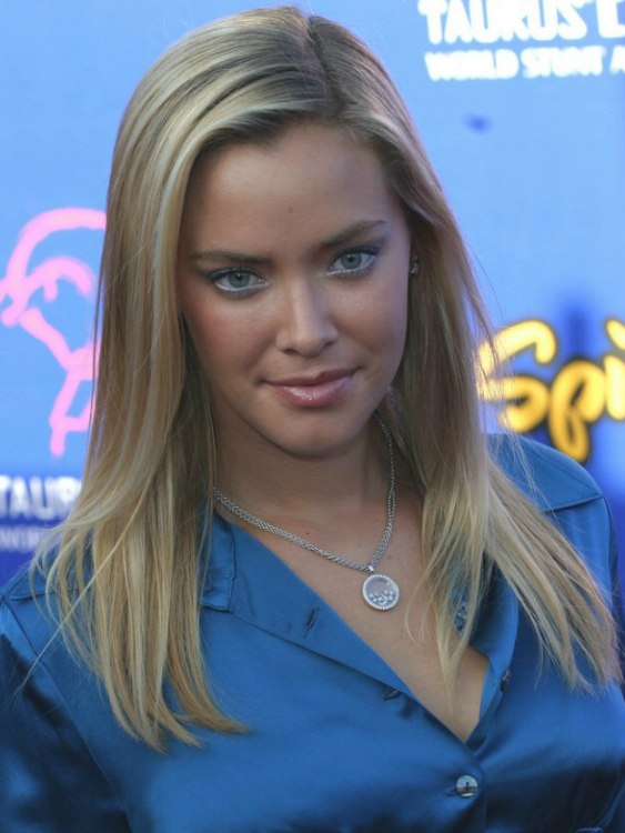 Kristanna Loken Wearing A Satin Blouse And Simple Long Hair