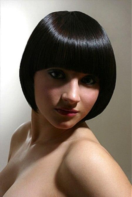 Super Sleek Bob Haircut With A Fringe That Follows The