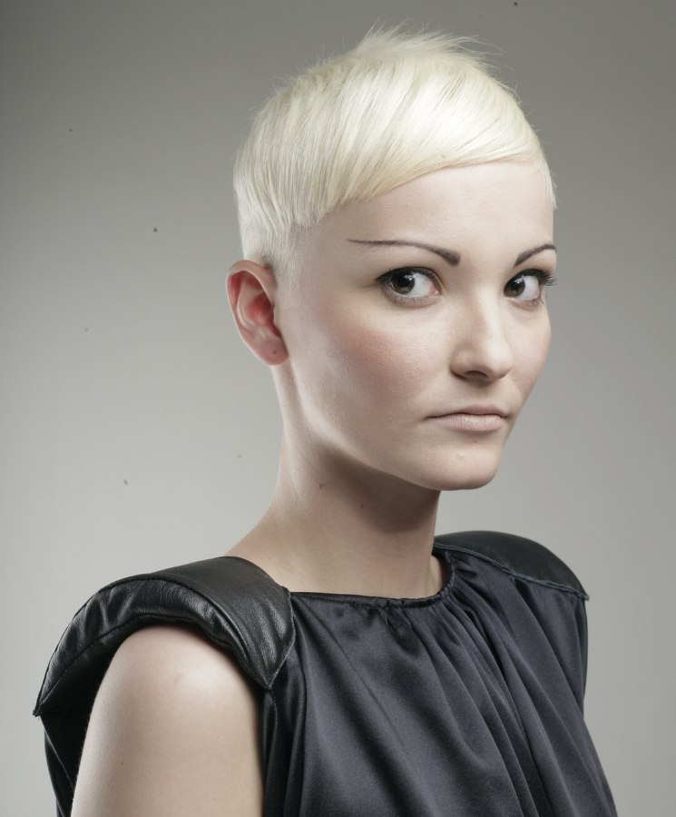 Short Haircut With A Strong Sculpted Shape And A White