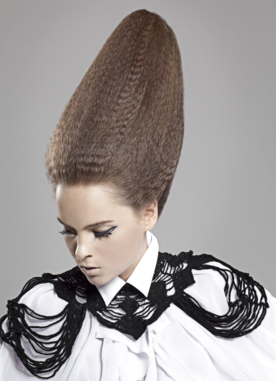 Updo With Rippled Hair Styled Into A Cone Conehead