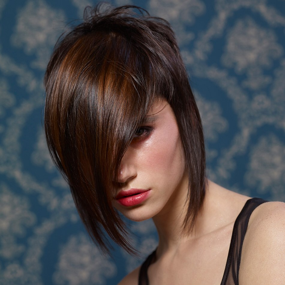 Dark Brown Medium Hairstyle With A Fringe That Covers Half