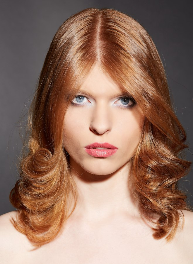 Shoulder Length Strawberry Blonde Hair With A Center Part