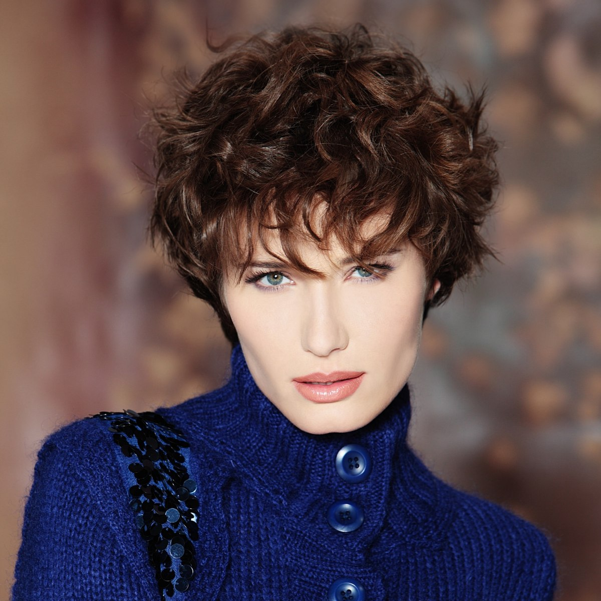 Soft Short Hairstyle With Curls And The Ears Just Covered