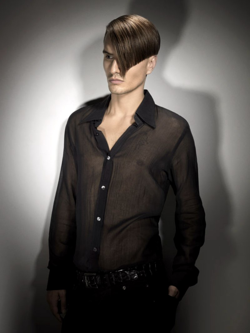 Sophisticated Mens Hairstyle With A Closely Clipped Nape