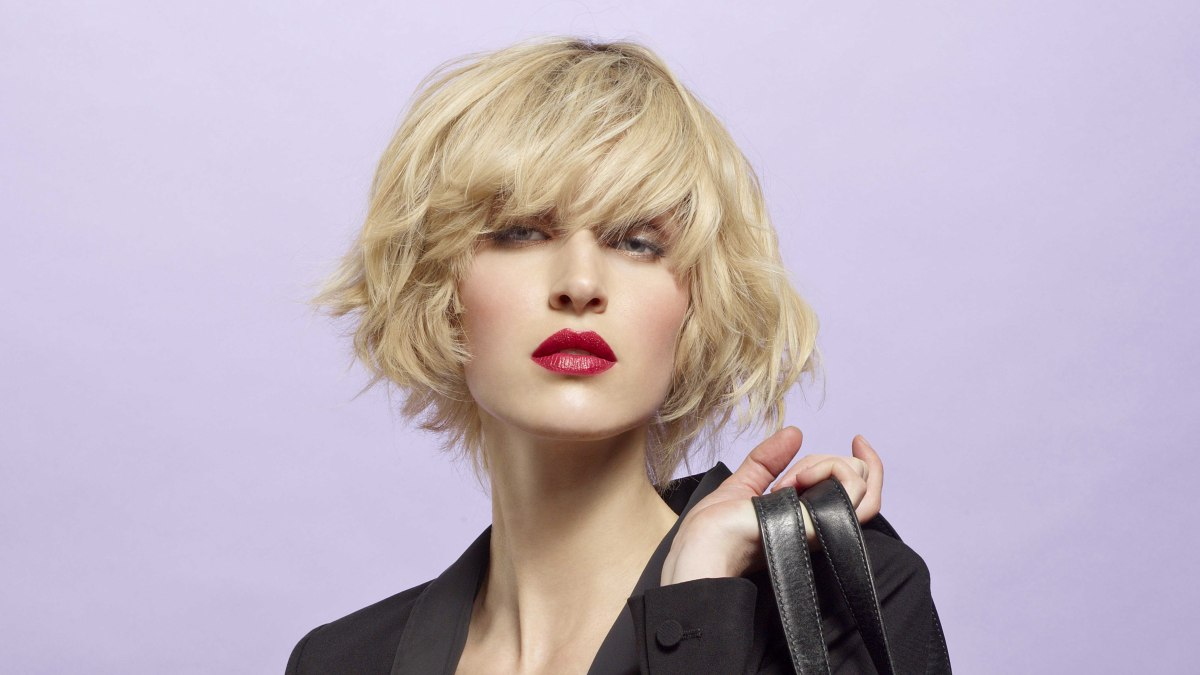 Blonde Chin Length Bob With Undone Styling And Thick Bangs