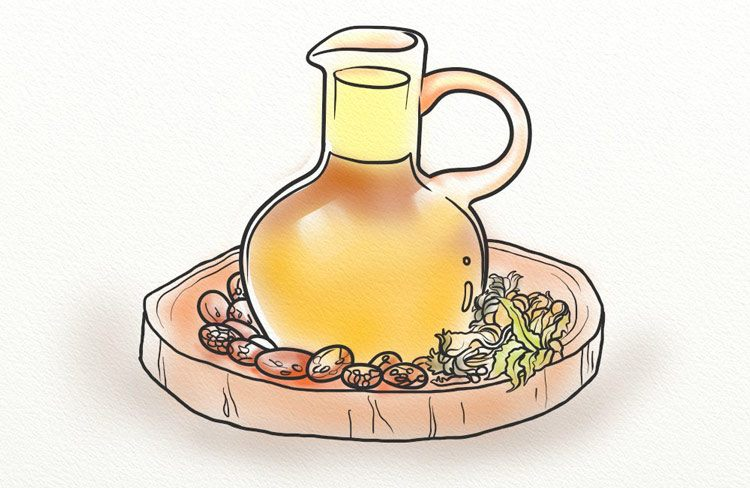 Castor seeds and oil in a wooden bowl