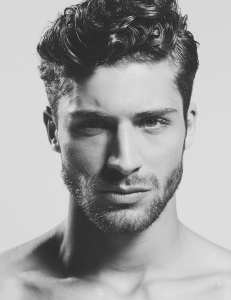 Thick-short-curly-hairstyle-for-men-with-stubble-beard
