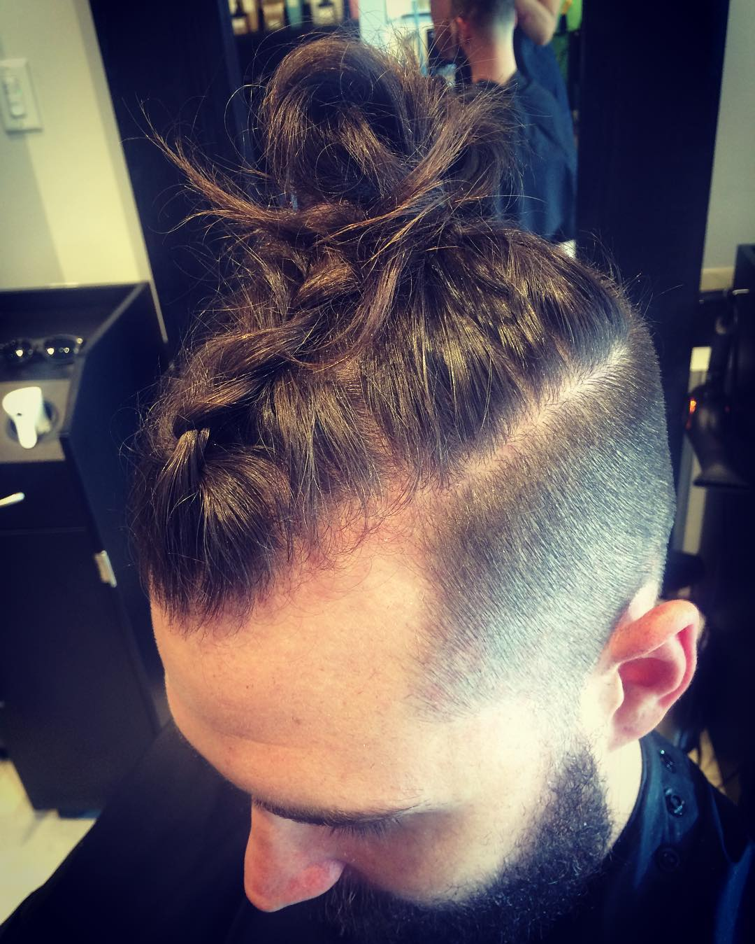 mohawk look with man bunand braid