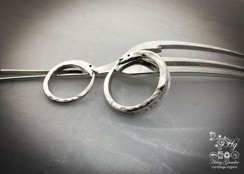 handcrafted and recycled silver fork ouroboros rings in the making
