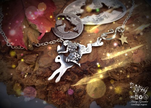 Handmade and recycled sterling silver fairy and hare necklace made from silver coins