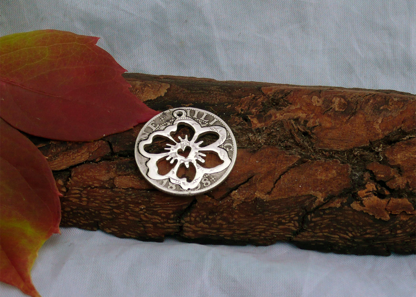 Handcrafted and recycled sterling silver shilling hawaiian flower necklace