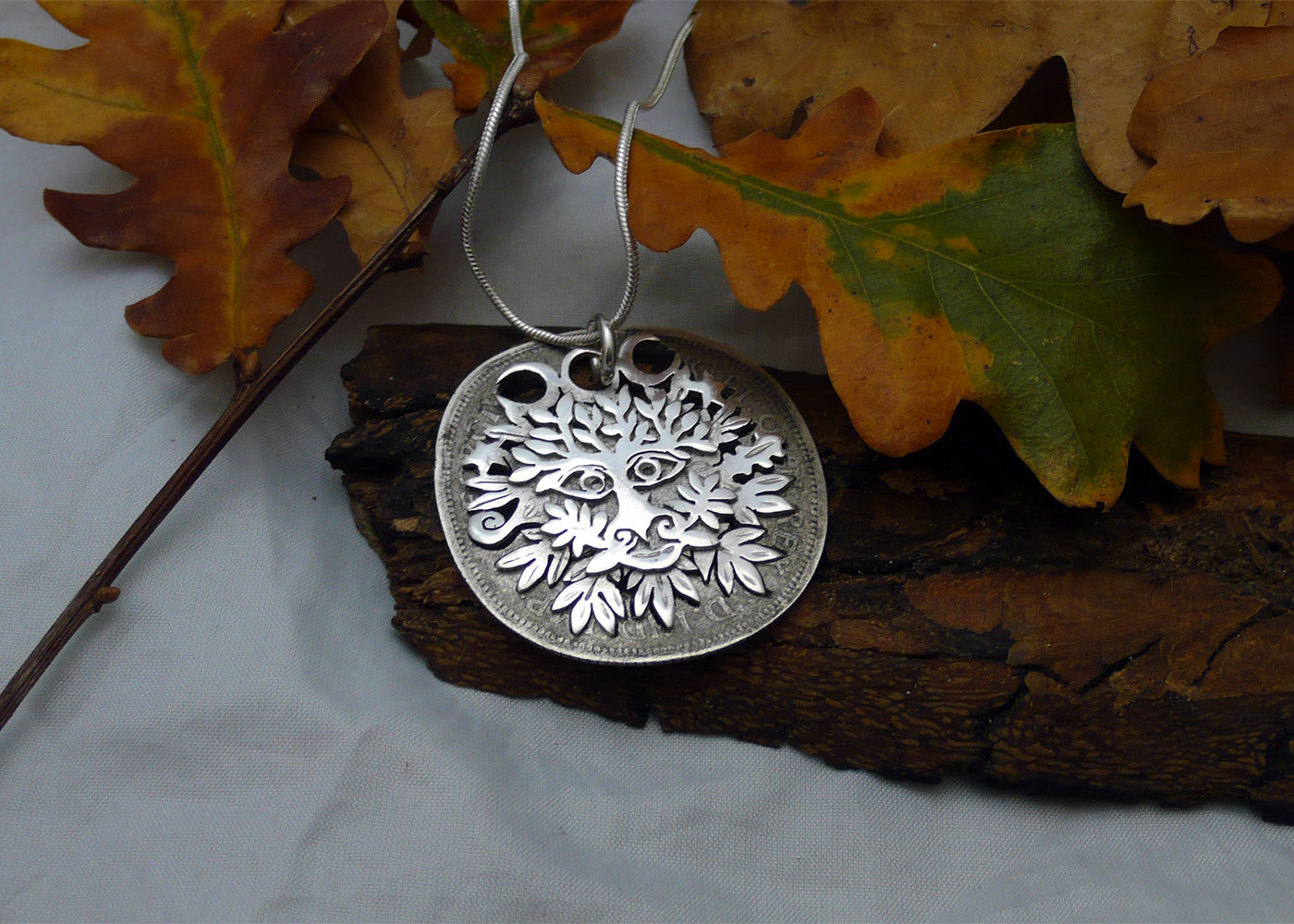 Handcrafted and recycled silver shilling greenman necklace reverse of coin