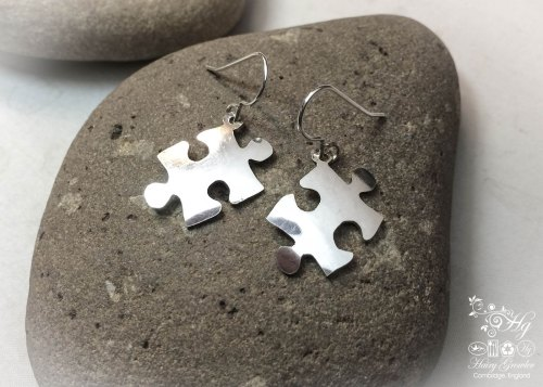 handmade and recycled spoon jigsaw-pieces earrings