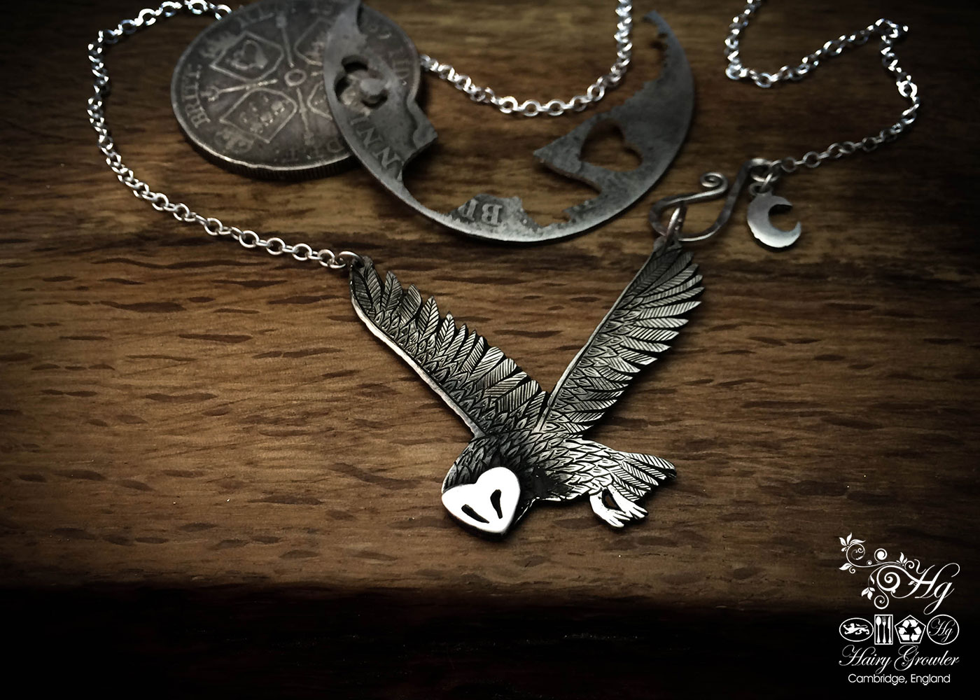 handcrafted and recycled silver coin flying owl necklace handmade in cambridge