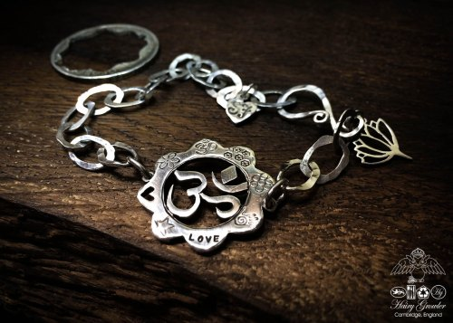 Om bracelet individually handcrafted and recycled from an old Victorian silver coins with lotus flower charm