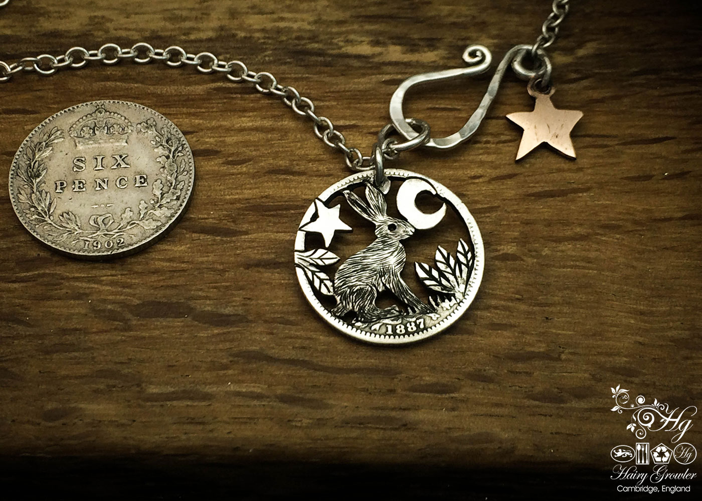 Handmade and upcycled silver sixpence coin hare pendant necklace