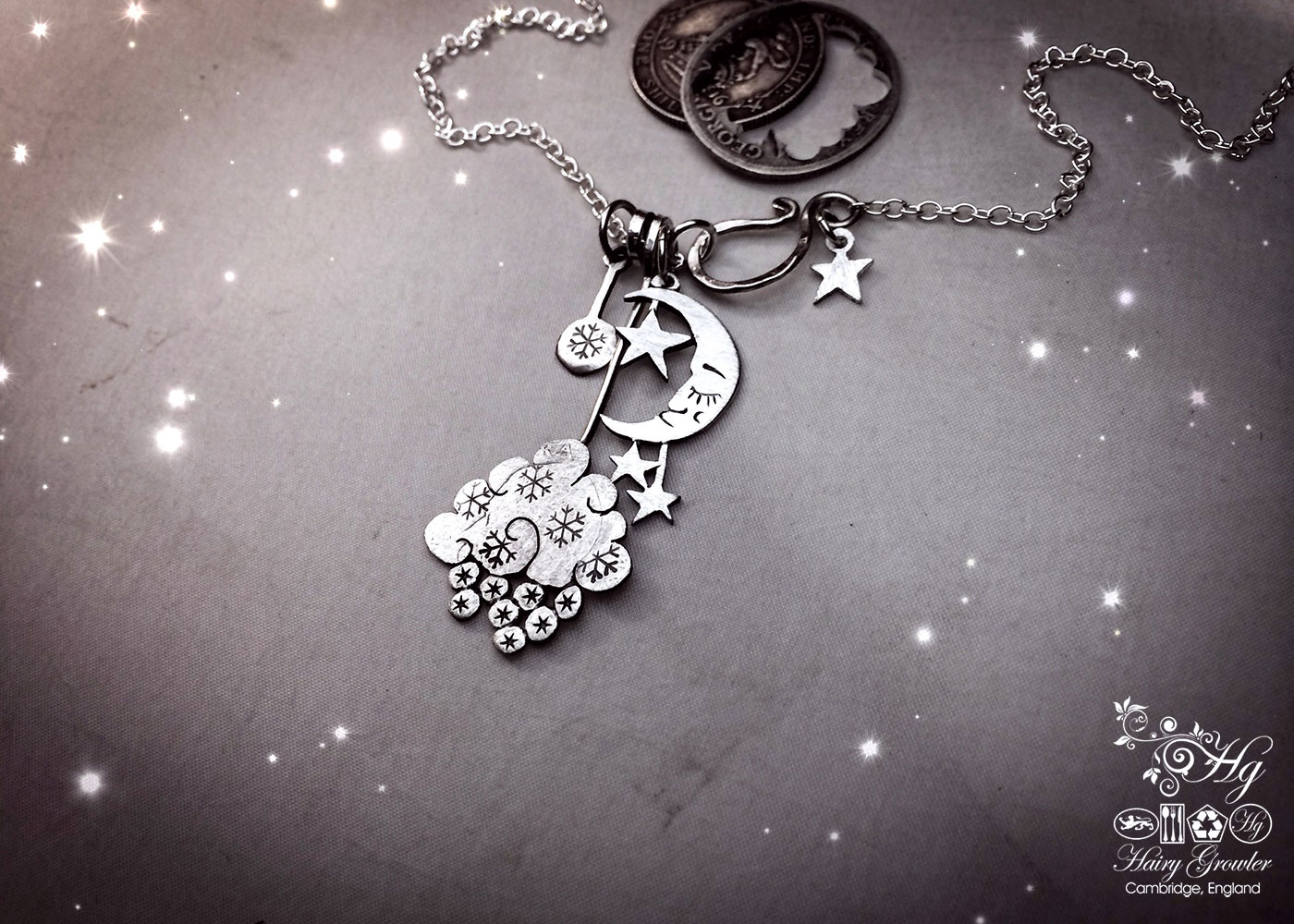 hand crafted and recycled sterling silver shillings and sixpence snowflakes and snow filled cloud