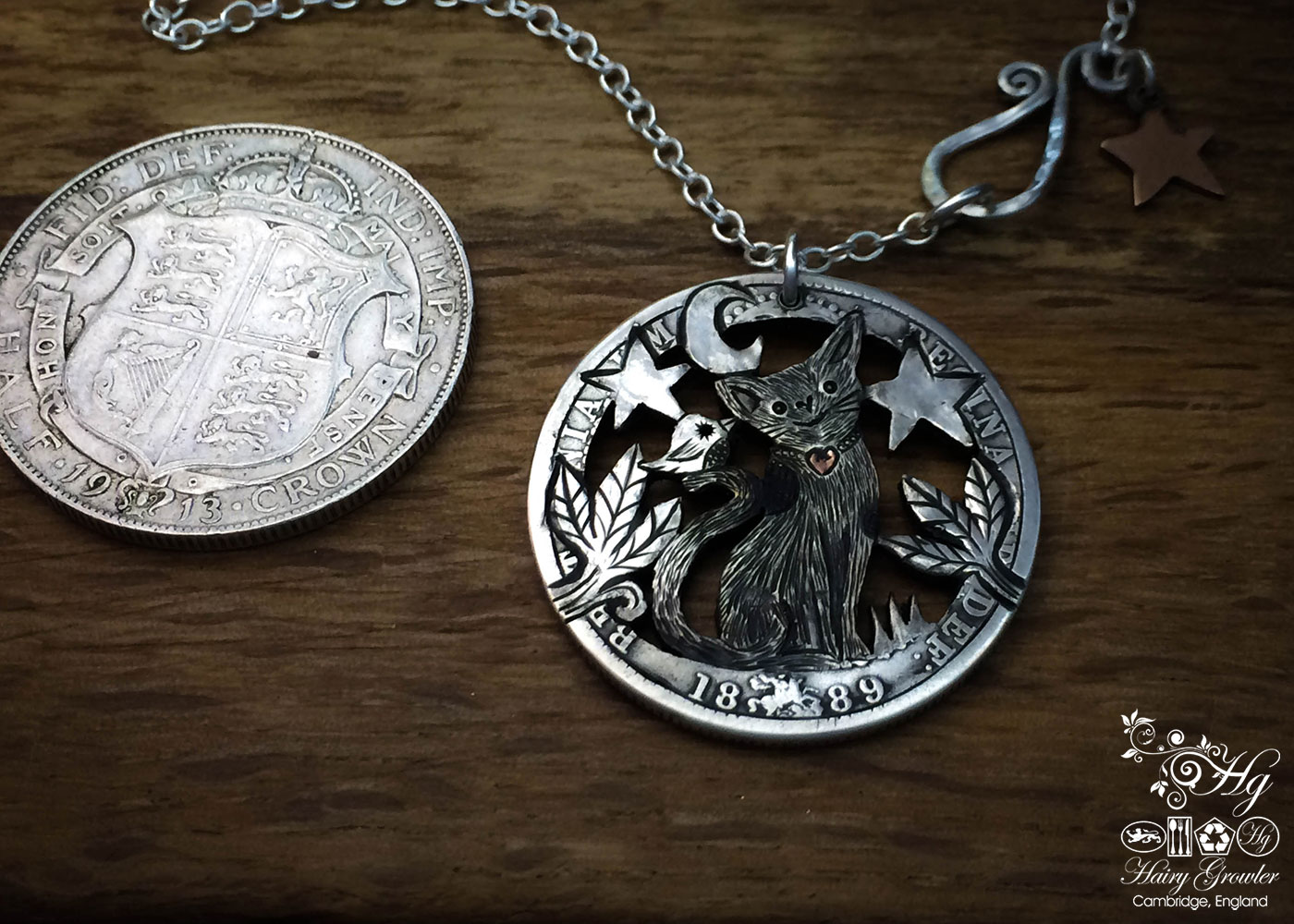 Handcrafted and recycled silver half crown coin cat and bird pendant necklace