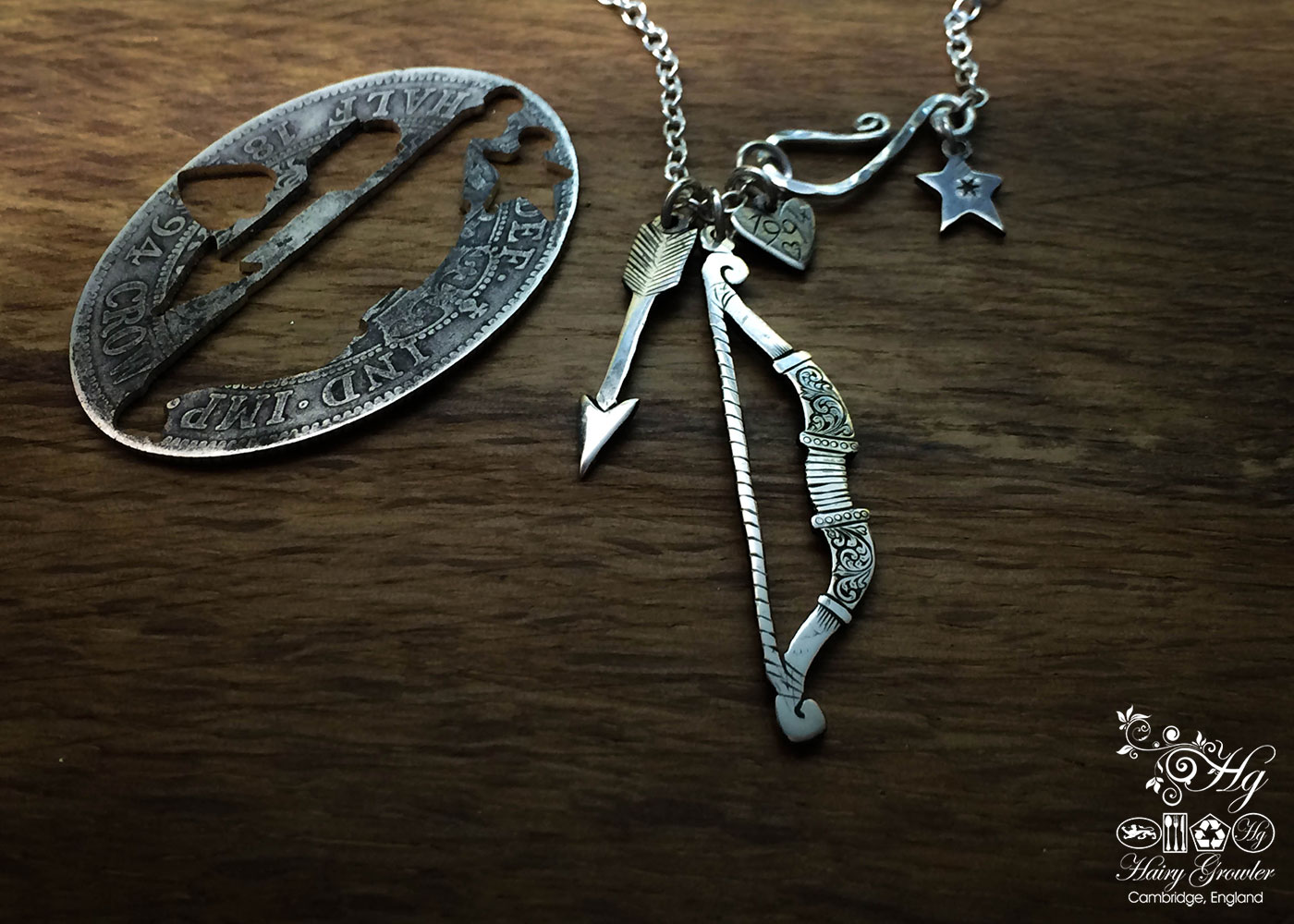 Handmade and upcycled sterling silver bow and arrow True Love necklaces