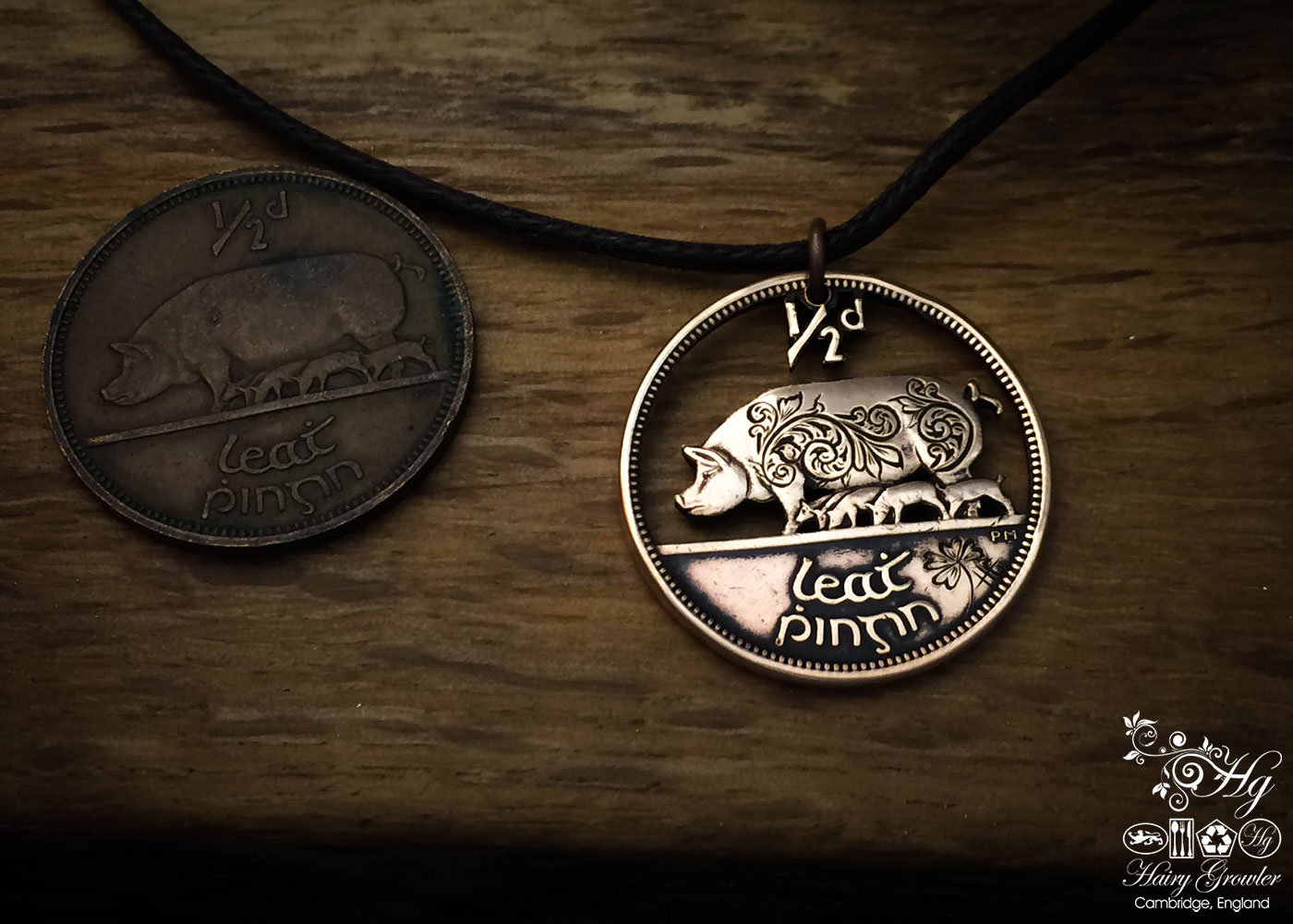 Hand-cut and carved with traditional flourish scrolls Irish pig half penny coin pendant